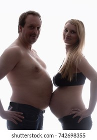Pregnant Woman and her Partner Measuring Bellies.