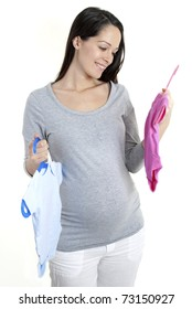 Pregnant woman holding baby girl and boy clothing