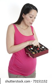 Pregnant woman holding box of chocolates - which one?