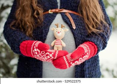 pregnant woman holding Christmas deer