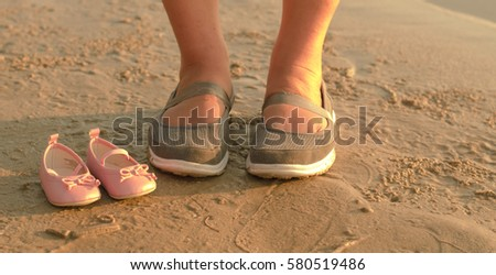 3a167a93f ... Stock Photo (Edit Now) 580519486 - Shutterstock. Pregnant woman holding  pink baby shoes on the beach in sunset
