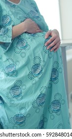 pregnant woman in hospital robe