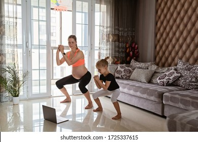 Pregnant woman and kid in sport clothing exercising at home. Online training during coronavirus covid-19 quarantine. Stay fit and safe during pandemic lockdown. Sport, fitness, healthy concept