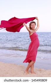pregnant woman on the beach with a handkerchief