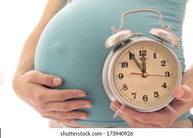 The pregnant woman on a white background Wait,