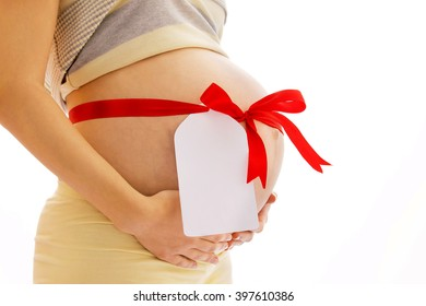 Pregnant woman on a white background with a sticker