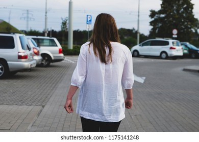 pregnant woman in the parking lot