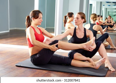 pregnant woman pilates exercise workout at gym with personal trainer