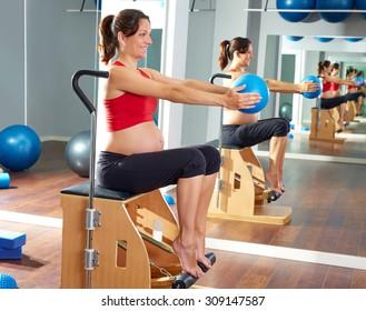 pregnant woman pilates leg pumps exercise on wunda chair