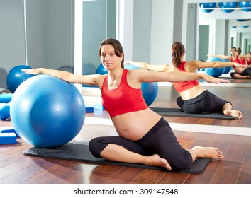 pregnant woman pilates mermaid fitball exercise workout at gym indoor
