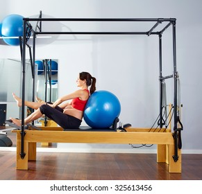 pregnant woman pilates reformer fitball exercise workout at gym