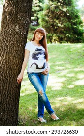 Pregnant woman portrait in the park