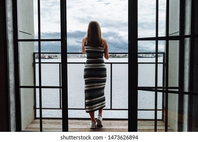 pregnant woman posing behind window