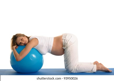pregnant woman practicing yoga with blue ball isolated on white