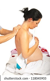 Pregnant woman receive back massage against white background