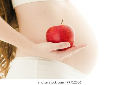 pregnant woman with red apple