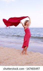 a Pregnant woman with a scarf on the beach