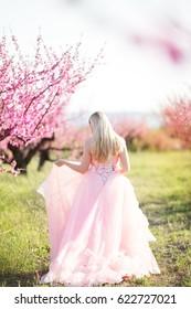Pregnant woman in spring garden