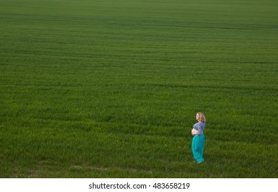 Pregnant woman standing on field