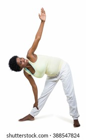 Pregnant woman stretching while doing exercise on white background
