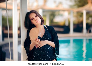 Pregnant Woman Suffering from Heat in Summer Season.  Mother to be having hot flashes and fanning herself