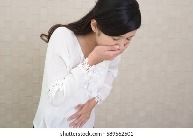 Pregnant woman suffering with nausea
