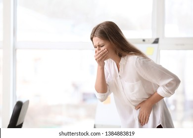 Pregnant woman suffering from toxicosis in office