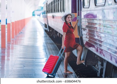 Pregnant woman tourist at the train station with tourists bag or luggage. Vacation concept.