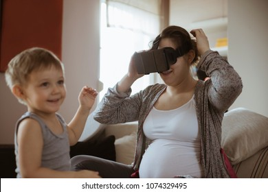 Pregnant Woman Using VR In The Livingroom