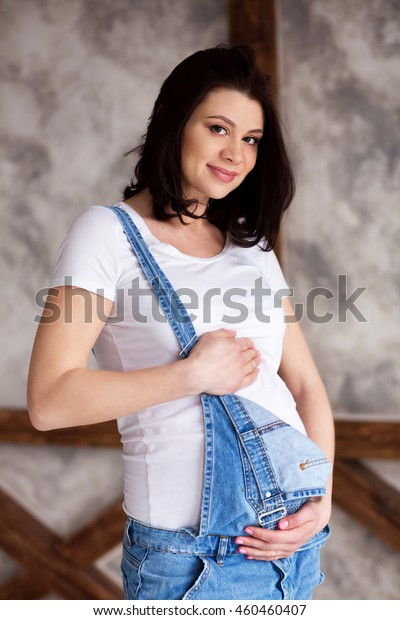 0f7320c7fb4e2 Pregnant Woman Wearing Jeans Overalls White Stock Photo (Edit Now ...