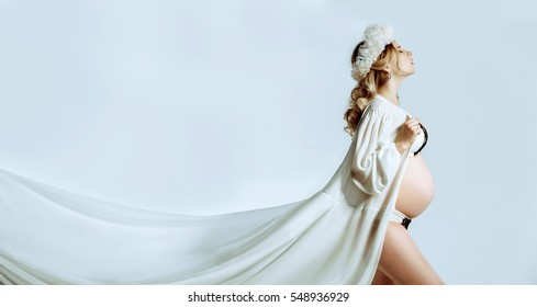 Pregnant woman in a white coat