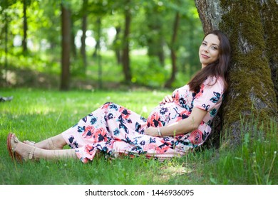 pregnant young woman in park