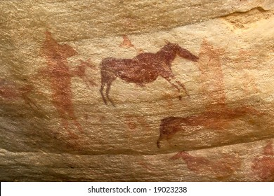 prehistoric african animals pictograph in busmen's tribal rock artwork in mountains of south africa