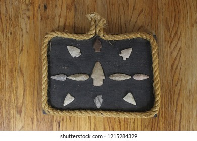 Prehistoric arrowheads mounted in a Western themed manner.