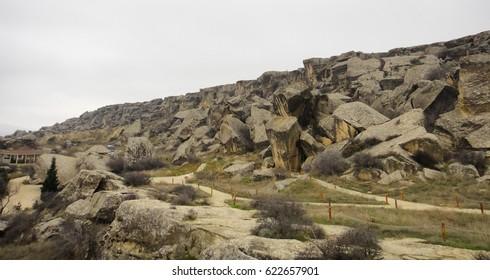 Prehistoric buildings. Gobustan National Park (Gobustan Rock Art Cultural Landscape) near Baku in Azerbaijan