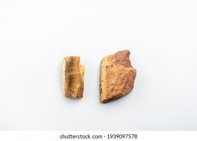 Prehistoric stones. Burin. Art of Acheulean culture from the Paleolithic period. Flint hand tools located in the Sahara desert. Two stone age tools on white background