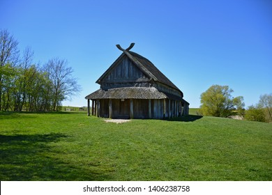 Prehistoric viking longhouse located in Denmark with a clear, blue sky on a sunny day