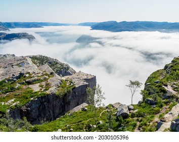 Preikestolen, the famous pulpit rock in a foggy day Norway