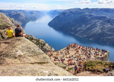 Preikestolen, Norway - July 23, 2016: Majestic Panoramic summer view of the world famous Preikestolen (Preacher's Pulpit or Pulpit Rock), Rogaland, Stavanger, Norway. Stunning Lysefjord as background