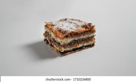 Prekmurska Gibanica (Slovenian specialty), pie with poppy seeds, nuts, raisins and cottage cheese