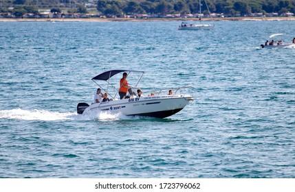 Premantura, Croatia, July 6 ,2019, rent speed boat going by the sea