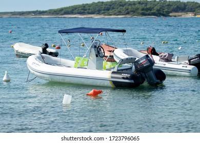 Premantura, Croatia, July 6 ,2019, sea boat with Yamaha engine in the port