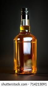Premium bourbon whiskey bottle on dark background. Perfect for label design mockups or presentations.