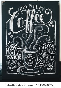 Premium coffee sign drawn in white chalk on a black chalkboard. Used in cafe, bistro, and restaurant.