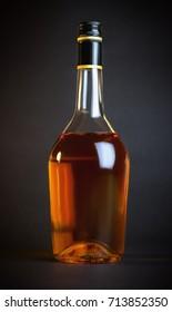 Premium cognac bottle on dark background. Perfect for design mockups and presentations.