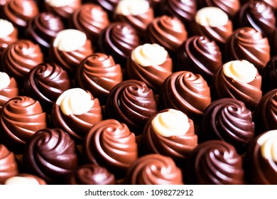 Premium collection of dark, milk and white chocolate sweets, selective focus. Chocolate background. Macro food photography. Collection of candies.