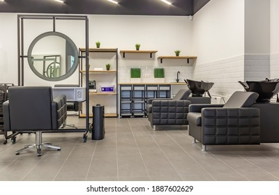 Premium coworking center for hair masters: workplace of the hairdresser with illuminated mirrors and comfortable chairs. Concept of contemporary interior design for hairdresser. Horizontal orientation