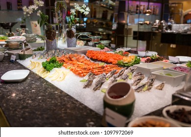 premium fresh raw buffet seafood and sashimi bar: Salmon, shrimp, oysters and mussels on ice