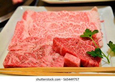Premium graded raw meat cuts prepared for expensive Japanese styled grilled set. Marble layer of fat make them a special luxurious meal at local restaurant in Japan.