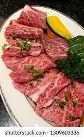 Premium Japanese wagyu A5 beef sliced on plate for yakiniku at Japanese restaurant.